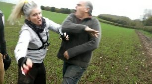 This is the dramatic moment a female hunt saboteur clashed with an angry man as she tied to monitor an event - and was left hospitalised with a cut to the face. See NTI story NTIHUNT; Extraordinary footage shows the woman and a colleague having a furious row with the male in a field. The West Midlands Hunt Saboteurs members claim they were trying to monitor members of the Warwickshire Hunt when the incident happened on Thursday (9/11) in Birdingbury, Warwicks.